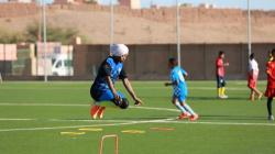 a girls team practising football in Morocco