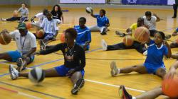 A group of young people practising basketball