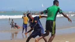 Boys playing football at Winneba Fishing Bay