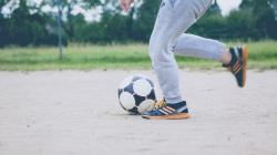 A child running with a soccer ball