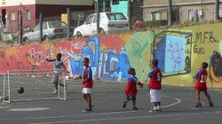 boys play soccer in an urban environment in South Africa