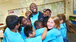 Sam Effah surrounded by children