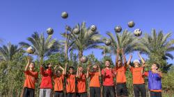 Boys in Egypt throwing soccer balls in the air