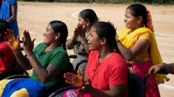 Indian women in wheelchairs cheering