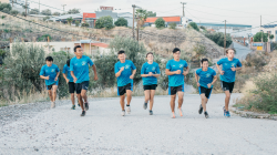 A group of refugees jogging on Lesvos