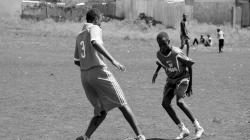 Boys playing soccer with Inuka Direct
