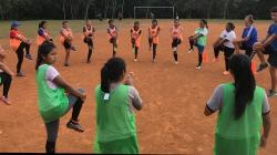 Girls in a circle preparing for a game