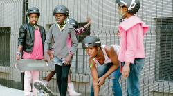 Four girls preparing to skateboard in South Africa