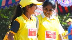 Two Indian girls preparing for a race