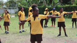 Males and females learning cricket in Papua New Guinea