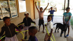 Children in South Africa playing with hula hoops