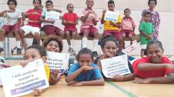 Participants in the PSP badminton gymnastics program in Port Moresby celebrate International Women's Day (Badminton PNG)