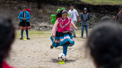 A woman in traditional Peruvian dress playing sport