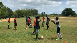 Boys playing football in South Trinidad