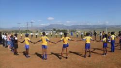 Children in South Africa holding hands in a circle