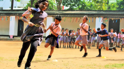 Children in India running in a game