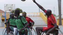 South Sudanese men in wheelchairs playing basketball