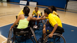 A group of young people in wheelchairs in a huddle